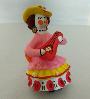 Dymkovo clay toy, the Lady in the chair