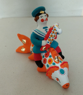 Dymkovo clay toy, the Rider on the fish