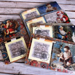 Souvenir fridge magnet with a notebook of Santa and Santas mix
