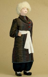 Doll gift porcelain.The Tatar traditional costume.