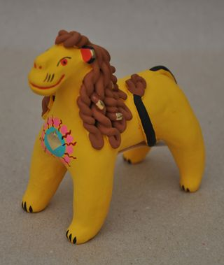 Lion with the emblem of the sun, Dymkovo clay toy
