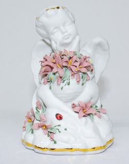 Figure porcelain angel with flowers