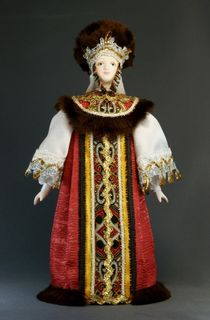 Doll gift porcelain. Festive princely garments with fur trimming.