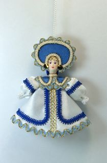 Doll pendant souvenir porcelain. Gzhel motifs.