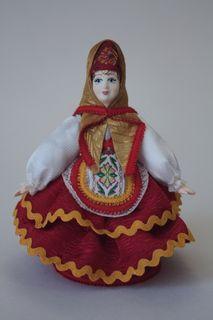 Doll gift porcelain. Matreshka - Dunya. Festive folk costume. Russia.