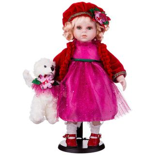 Porcelain doll in a red beret