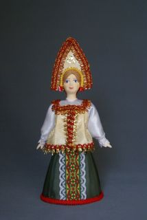 Doll gift porcelain. Russian maiden traditional dress (styling).