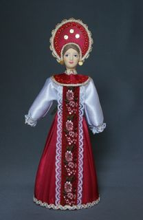 Doll gift porcelain. Russian maiden costume.