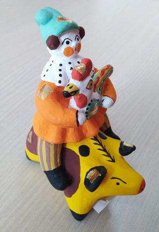 Dymkovskaya earthenware toy Rider on a pig with a rooster