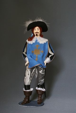 Doll gift. Musketeer of the king Louis 13., 17th-century France.