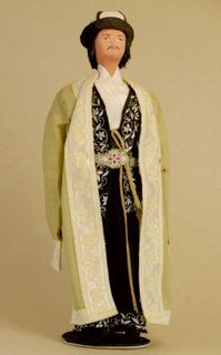 Doll gift porcelain. Kyrgyz festive costume. Turkestan. Late 19th - early 20th century.