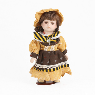 Porcelain doll Girl yellow-brown dress