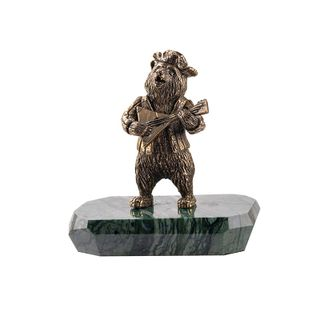"A statuette ""Bear with balalaika"" on the stone"