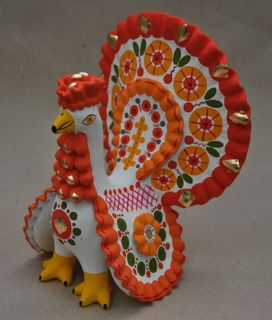 Dymkovo clay toy, the Turkey painted with a red tail