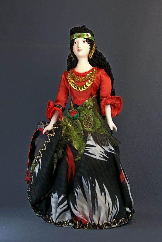 Doll gift porcelain. A Gypsy woman in traditional dress. Late 19th - early 20th century, Bessarabia. Russia.