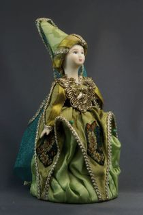 Doll gift porcelain. Sorceress. Fairy tale character.