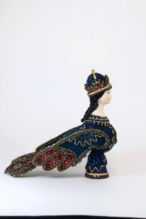 Doll gift porcelain. The Bird Sirin. Folklore character.