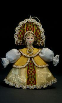 Doll pendant souvenir porcelain. The girl in desagree.