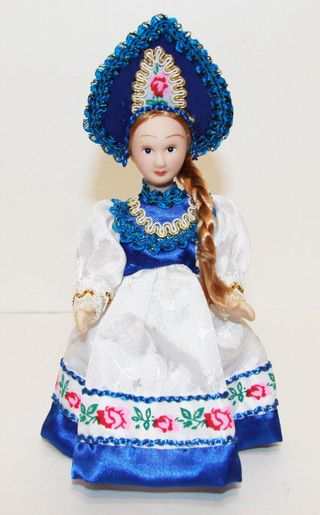 Porcelain doll in a blue kokoshnik