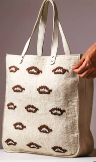 Hand-embroidered felt bag with leather