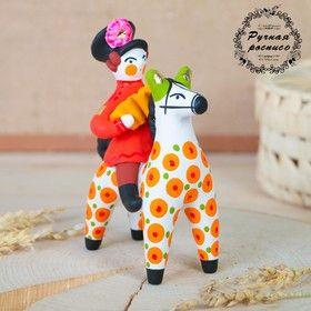 Dymkovo clay toy Accordion on a horse