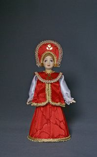 Doll gift porcelain. Russian holiday costume.