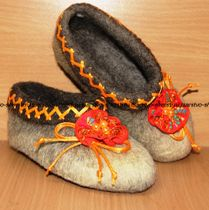 Slippers for children from natural sheep wool