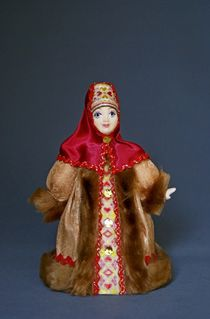 Doll gift porcelain. Boyarynya dressed in winter clothes. 17-18 century. Russia.