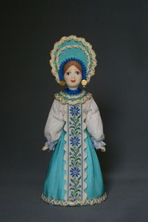 Doll gift porcelain. Stylized maiden costume.