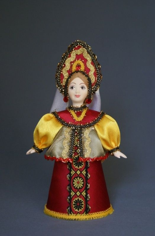 Doll gift porcelain. Traditional girl suit. Russia.