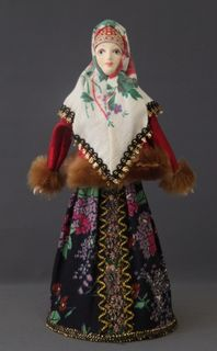 Traditional winter maiden costume. Doll gift