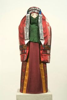 Doll gift porcelain. Traditional Turkmen-Teke women's costume. Late 19th - early 20th century.