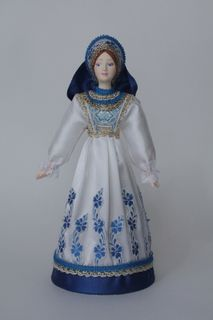Doll gift porcelain. Maiden costume on motives of Gzhel craft. Russia.