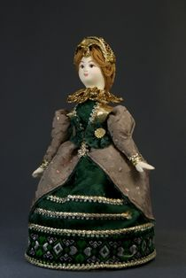 Doll gift porcelain. The lady in secular costume. The end of the 16th century, Spain.