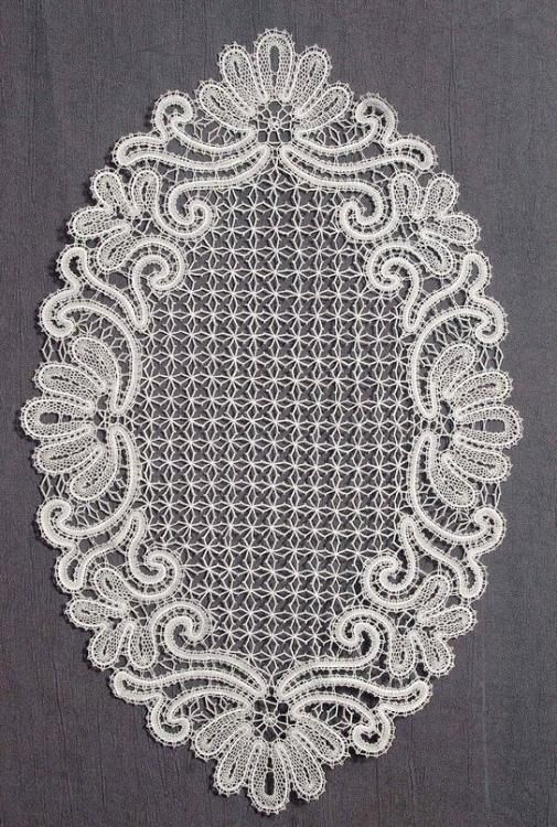 Doily lace oval with ornaments in the form of fans