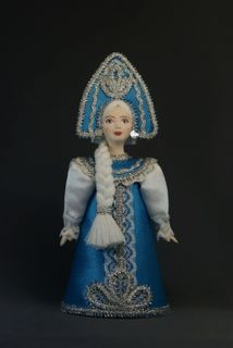 Doll gift. The snow maiden. Fairy tale character.