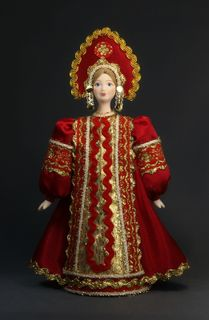Doll gift porcelain. Russian girl in national costume.