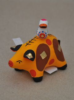 Dymkovo clay toy Pig with a bird
