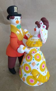 Dymkovo clay toy, the Dance of the bride and groom