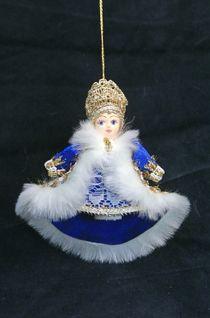 Doll pendant souvenir porcelain. Boyar in winter coat.