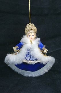 Doll pendant souvenir porcelain. Boyar in winter coat.
