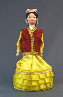 Doll gift porcelain. Kasimov. The Volga region. Russia. Maiden Tatar costume. Late 19th-early 20th century