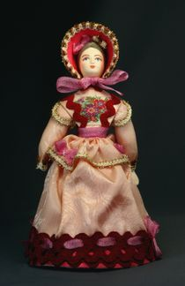 Doll gift porcelain. A young lady in a secular dress and bonnet. 1830, Russia. The European fashion.