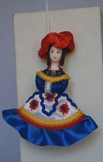 Doll pendant souvenir porcelain.The lady. The motifs painted Dymkovo toys.