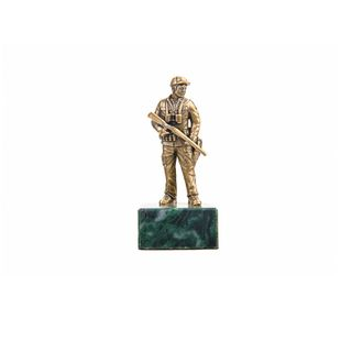 "A statuette ""Hunter with a gun"" on the stone"