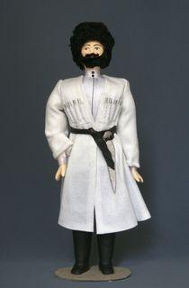 Doll gift porcelain. North Caucasus. Men's festive costume.