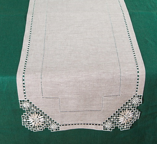 Track with openwork embroidery