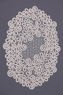 Doily lace with a pattern of sprigs of flowers
