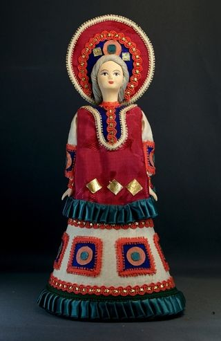 Doll gift porcelain. Girl in holiday outfit. In explanation Dymkovo toys.