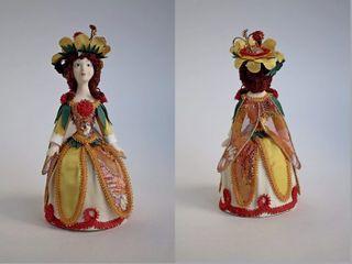 Doll gift porcelain. Fairy in a flower dress. Fabulous image.